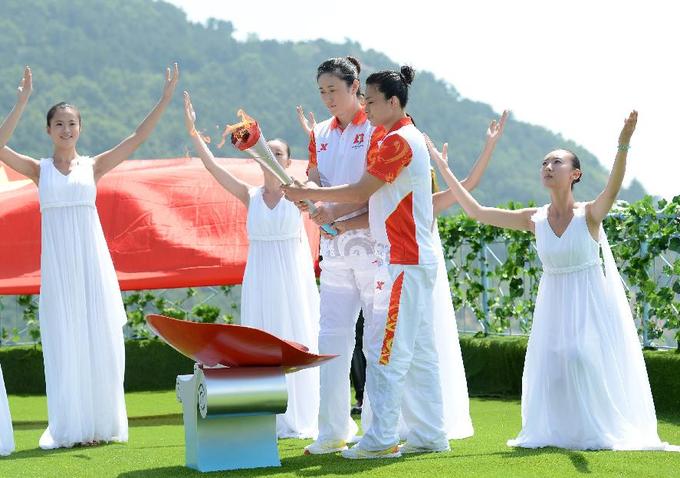 Đại hội thể thao Trung Quốc 'đạo' ý tưởng thắp lửa Olympic