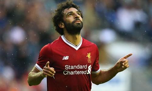 Salah đang có phong độ cao trong màu áo Liverpool. Ảnh: PA.