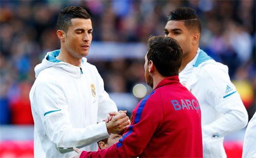 Real của Ronaldo mới thua Barca của Messi trong trận El Clasico. Ảnh: Reuters