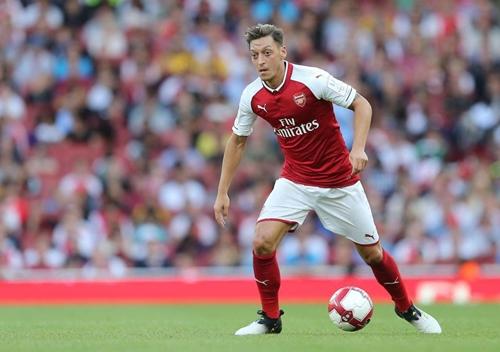 Ozil luôn là ngôi sao hàng đầu, kể từ khi gia nhập Arsenal hè 2013. Ảnh: PA.