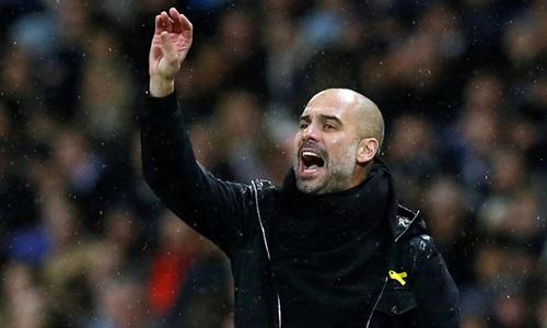 Guardiola cho rằng lịch thi đấu tại Anh đang hủy hoại cầu thủ. Ảnh: Reuters.