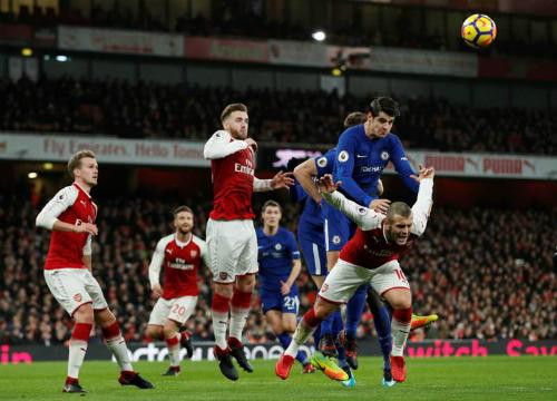 Morata (xanh) có một trận đấu đáng quên. Ảnh: Reuters.