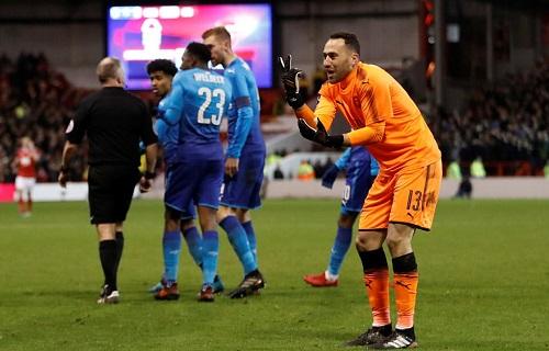 Cầu thủ Arsenal phản ứng với bàn thắng thứ tư của Nottingham. Ảnh: Reuters.
