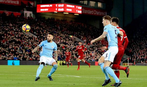 Cú lốp bóng đẳng cấp của Firmino mở màn cho 10 phút điên rồ của Liverpool trong hiệp hai. Ảnh:PA.
