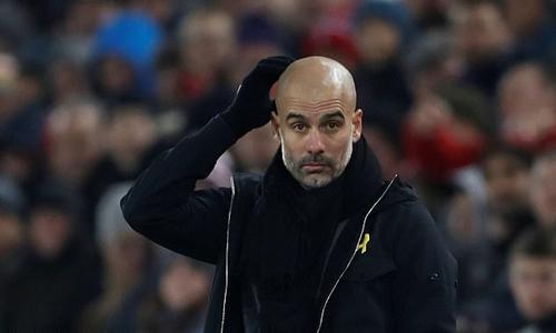 Guardiola nhận thất bại đầu tiên sau 12 tháng. Ảnh: Reuters.