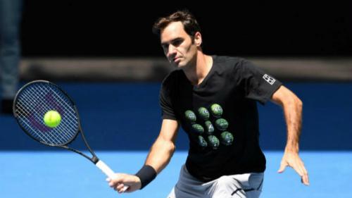 Federer tập luyện cho Grand Slam đầu tiên trong năm. Ảnh: DPA.
