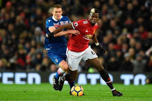 Pogba (áo đỏ) có hiệu quả thi đấu rất cao trong màu áo Man Utd. Ảnh: Reuters