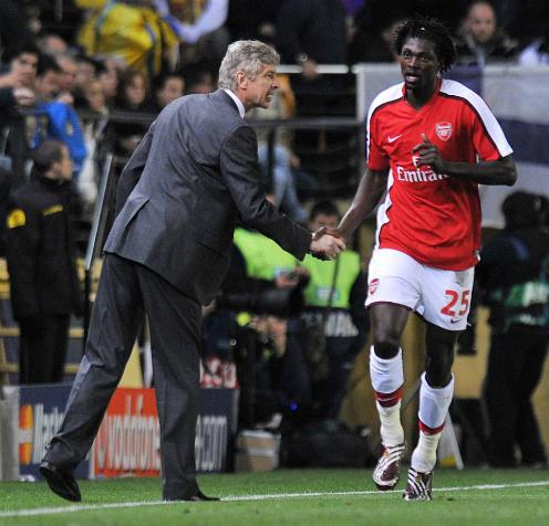 Wenger và Adebayor có ba năm rưỡi làm việc cùng nhau ở Arsenal. Ảnh:AFP.