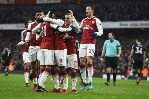 Niềm vui trở lại với các cầu thủ Arsenal. Ảnh:EPA.