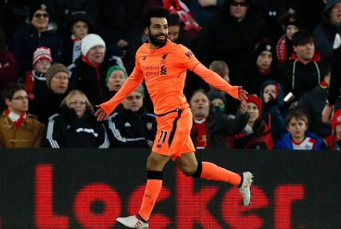 Tiền đạo người Ai Cập chỉ kém một bàn so với chân sút dẫn đầulà Harry Kane. Ảnh:AFP.