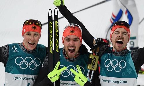 Ba VĐV Đức giành trọn bộ huy chương ở nội dung10km đồi lớn cá nhân của môn trượt tuyết Bắc Âu. Ảnh: AFP.