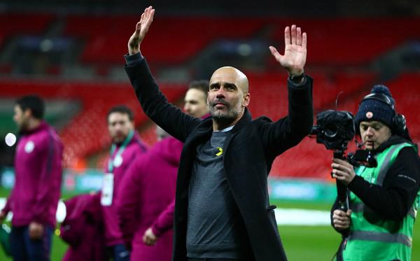 Guardiola có danh hiệu đầu tiên cùng Man City. Ảnh: Reuters.