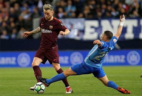 Malaga nỗ lực để tránh thua đậm hơn.