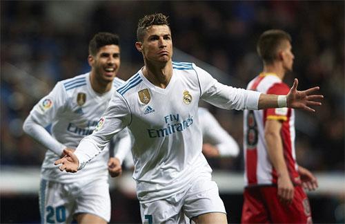 Ronaldo và đồng đội trút mưa bàn thắng lên Girona. Ảnh: Reuters