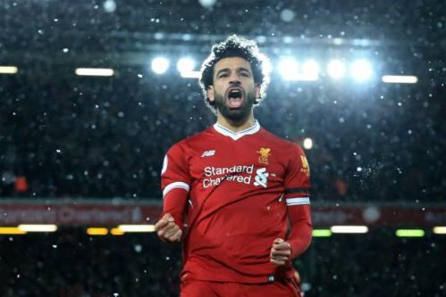 Salah trên đường ghi dấu ấn trong lịch sử Liverpool ngay ở mùa đầu tiên. Ảnh:AFP.