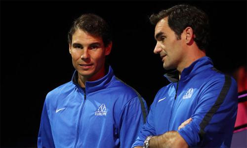Nadal tái chiếm ngôi số một từ Federer nhưng khógiữ vị trí này sau mùa sân đất nện. Ảnh: AFP.