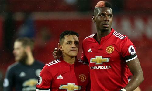 Pogba và Sanchez đều đang gặp khó khăn ở Man Utd. Ảnh: Reuters.