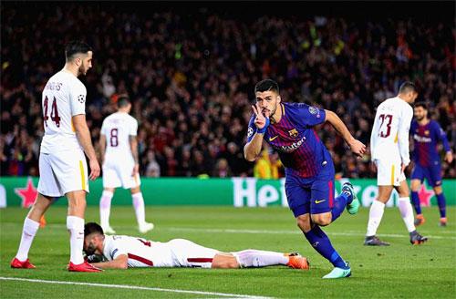 Luis Suarez ấn định chiến thắng, đồng thời ghi bàn đầu tiên tại Champions League mùa này. Ảnh: Reuters