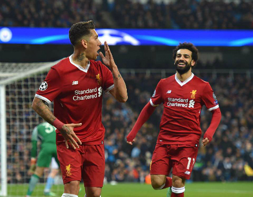 Firmino giúp Liverpool thắng cả hai lượt trận trước Man City. Ảnh:DM.