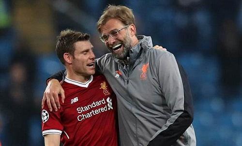 Milner cho rằng Liverpool học được nhiều điều từ hai trận đấu với Man City. Ảnh: AFP.