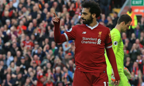 Mùa giải đầu tiên khoác áo Liverpool nhưng Salah trên đường đi vào lịch sử câu lạc bộ. Ảnh:AFP.