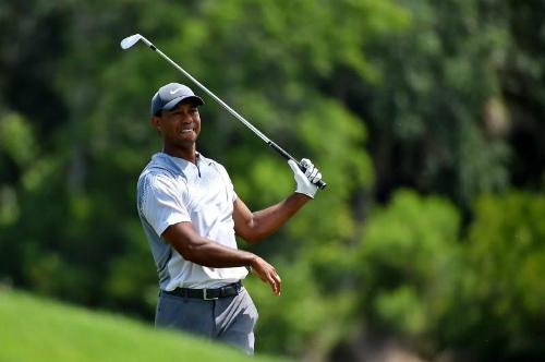 Tiger Woods hoàn toàn lột xác ở vòng ba The Players với tám birdie và một bogey. Anh đang chơi tốt ở TPC Sawgrass khi chưa dương gậy vòng nào.Ảnh: Reuters.