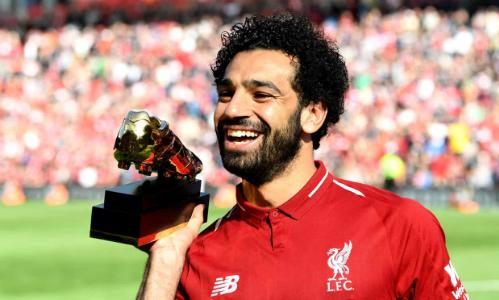 Salah nhận danh hiệu Vua phá lưới Ngoại hạng Anh sau trận đấu với Brighton. Ảnh:AFP.