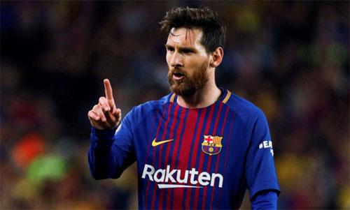 Messi dẫn dắt Barca giành lại La Liga sau một năm chịu thua Real. Ảnh: Reuters