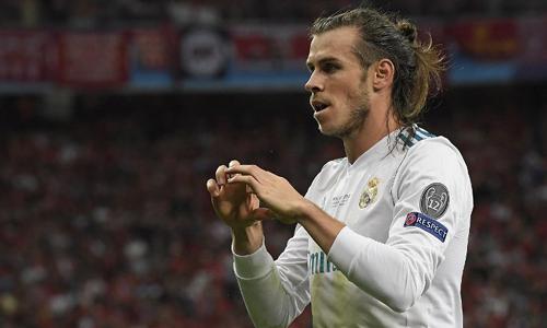 Bale lập cú đúp sau khi vào sân, giúp Real đánh bại Liverpool. Ảnh: AFP.