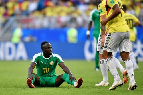 Nỗi buồn của Sadio Mane khi Senegal bị loại bởi hai thẻ vàng. Ảnh: AP.