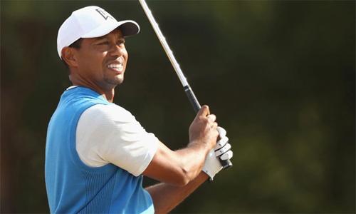 Woods chơi vòng đầu tiên tại The Open sau ba năm và đạt số gậy chuẩn 71. Anh có ba birdie nhưng mắc ba bogey. Ảnh: Golfweek.