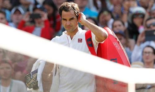 Federer bị loại ở tứ kết Wimbledon 2018. Ảnh: Reuters.