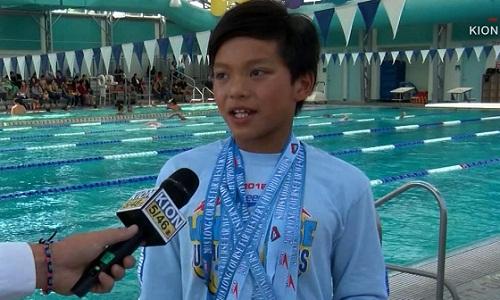 Clark Kent phá kỷ lục MichaelPhelps lập ở nội dung 100m bướm khi 10 tuổi. Ảnh: CNN.