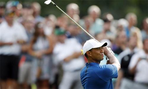 Woods chơi vòng mở màn khá tốt với 66 gậy. Anh từng tám lần vô địch WGC-Bridgestone Invitational. Ảnh: Reuters.