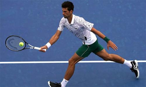 Djokovic qua cơn bĩ cực trong trận đấu với Dimitrov tại vòng ba. Ảnh: Indian Express.