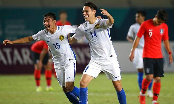 Malaysia chắc chắn đứng đầu bảng E và sẽ gặp đội nhì bảng D - bảng đấu có Việt Nam - ở vòng 1/8. Ảnh: AP.