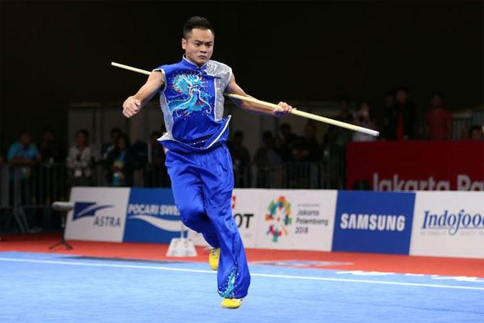 Quốc Khánh thi nam côn, mang về HC bạc thứ hai cho đoàn thể thao Việt Nam tại Asiad 2018. Ảnh:Lâm Thỏa.