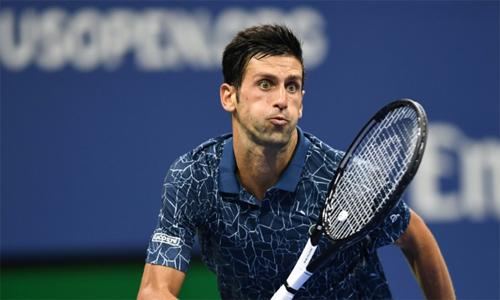 Djokovic tiếp tục gặp khó khăn ở vòng ba trước Sandgren, dù từng vùi dập đối thủ này 6-3, 6-1, 6-2 ở Wimbledon tháng trước. Ảnh: AFP.