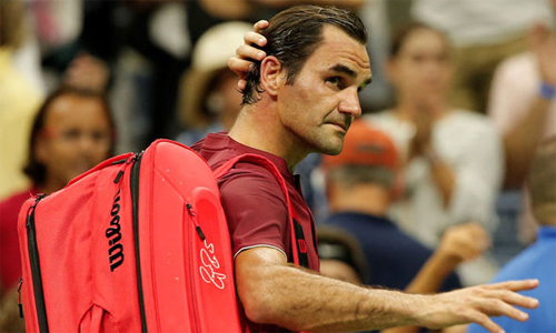 Federer chỉ trích điều kiện thi đấu tại sânArthur Ashe sau khi bị loại ở vòng bốn. Ảnh: AP.