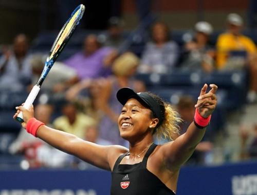 Niềm vui của Osaka sau khi giành chức vô địch Mỹ Mở rộng. Cô là tay vợt người Nhật Bản đầu tiên giành Grand Slam. Ảnh: Reuters.