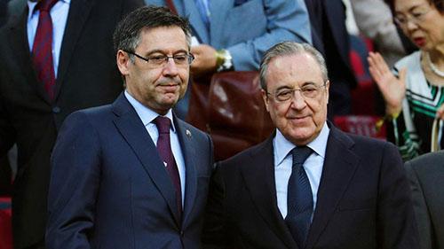 Chủ tịch Florentino Perez (phải) yên tâm với nền tảng tài chính của Real hơn hẳn người đồng cấpJosep Maria Bartomeu của Barca. Ảnh: Reuters.