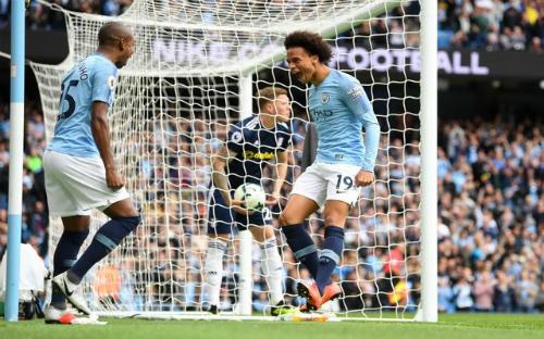 Sane (phải) đóng góp một bàn trong chiến thắng của Man City.
