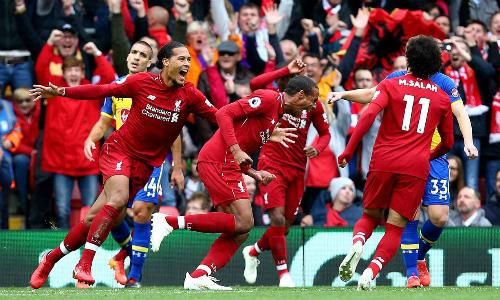 Liverpool lần đầu tiên trong lịch sử thắng cả bảy trận đầu mùa ở giải vô địch Anh. Ảnh: PA.