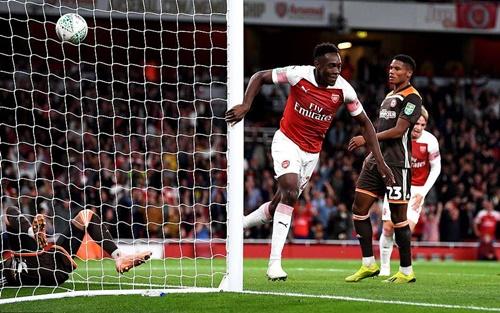 Welbeck là người hùng của Arsenal tối 26/9. Ảnh: PA.