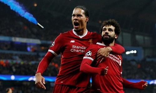 Van Dijk và Salah là trụ cột trong lối chơi của Liverpool. Ảnh: Reuters.
