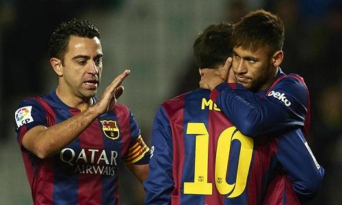 Xavi từng là đàn anh của Messi và Neymar tại Barca. Ảnh: AFP.