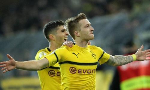 Reus giúp Dortmund có chiến thắng chật vật. Ảnh: AFP.
