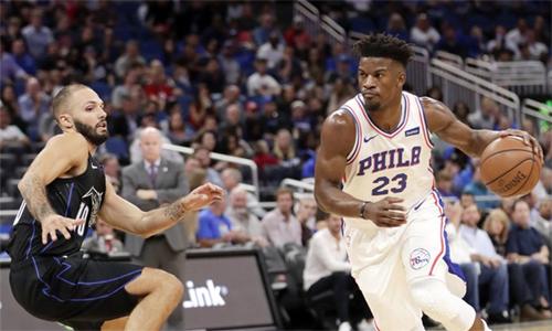 Jimmy Butler (phải) ra mắt không như ý tại Philadelphia 76ers. Ảnh: AP.