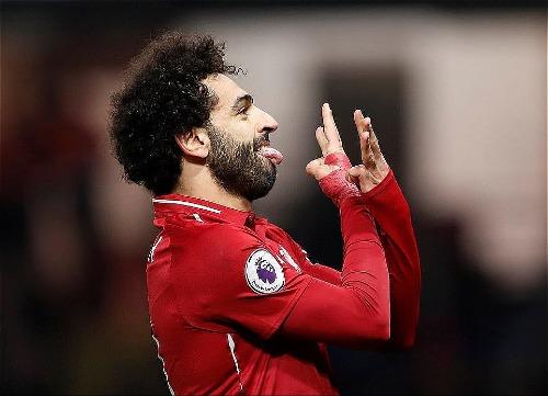 Salah ghi bàn thắng thứ bảy tại Ngoại hạng Anh mùa này. Ảnh:Reuters.