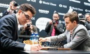 Vua cờ Carlsen bất phân thắng bại với Caruana qua 12 ván